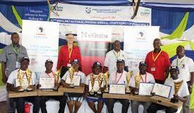 Past iTOYA National winners display their awards.