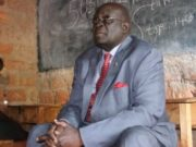 Education CS George Magoha inspects a past KCSE practical examination.
