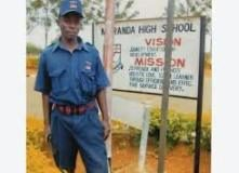 A Security officer. Schools have been ordered to trim excess support staff.