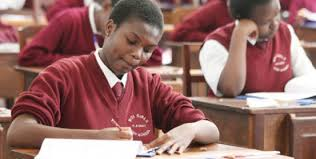 Students sitting an exam. Some KCSE 2019 students are crying foul after being placed in TVETs even after attaining university minimum entry grade of a C+